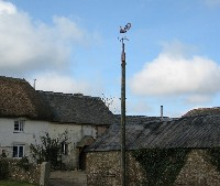 weathercock and 3 foot copper spire mounted on a defunct telegraph post.