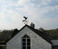 puffin weathervane mounted on end gable, with custom bracket